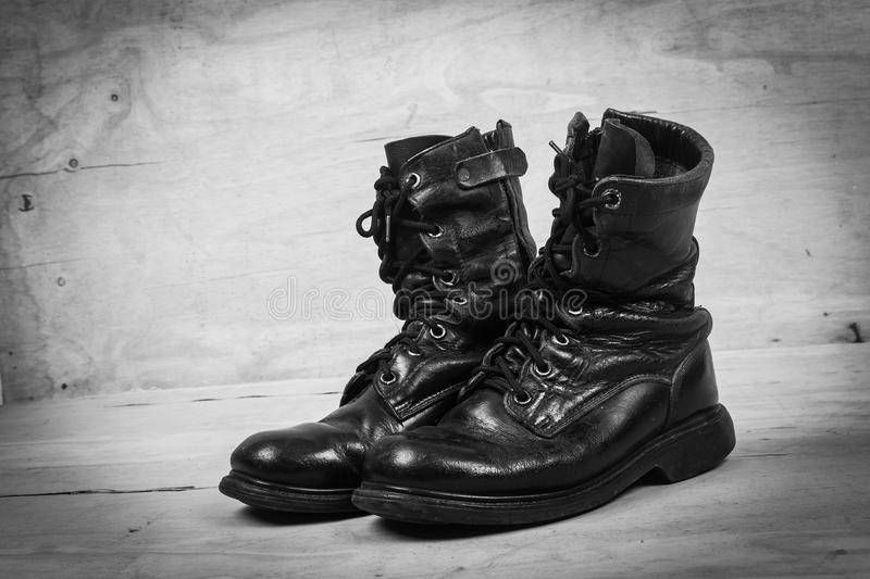 Old black combat boots. Back and white tone stock photo