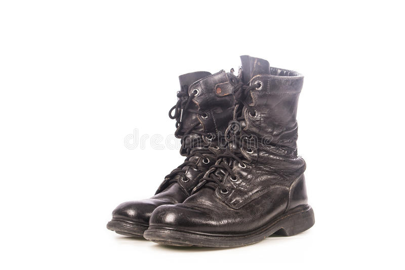 Old black combat boots royalty free stock photos