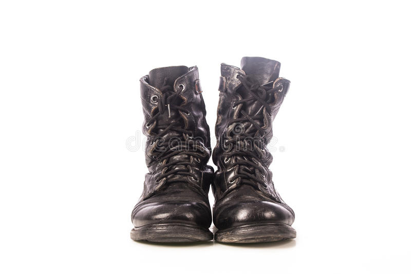 Old black combat boots. On white background royalty free stock image