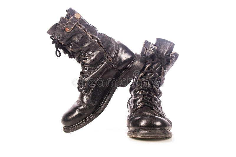 Old black combat boots. On white background stock photos