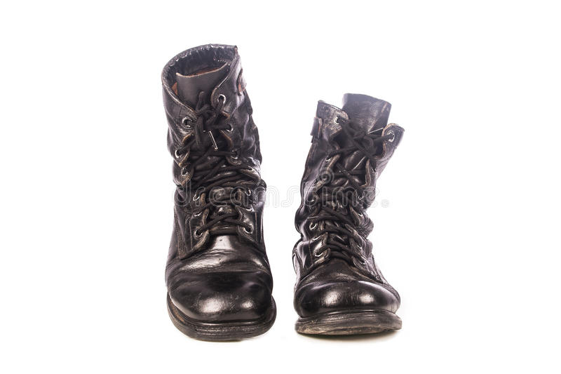 Old black combat boots. On white background stock image