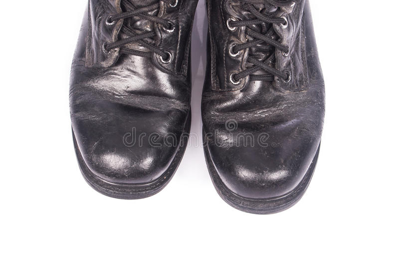 Old black combat boots. On white background stock photography