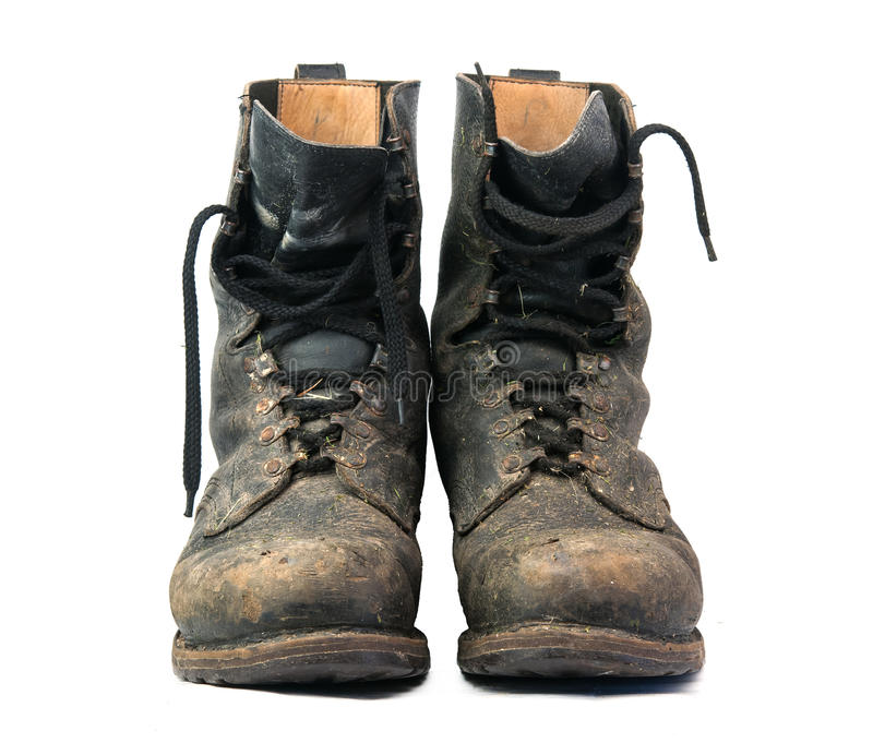 Old black combat. Boots on white background stock photography