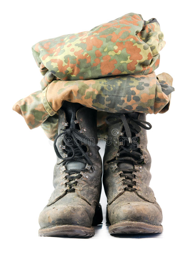 Old black combat. Boots on white background stock images