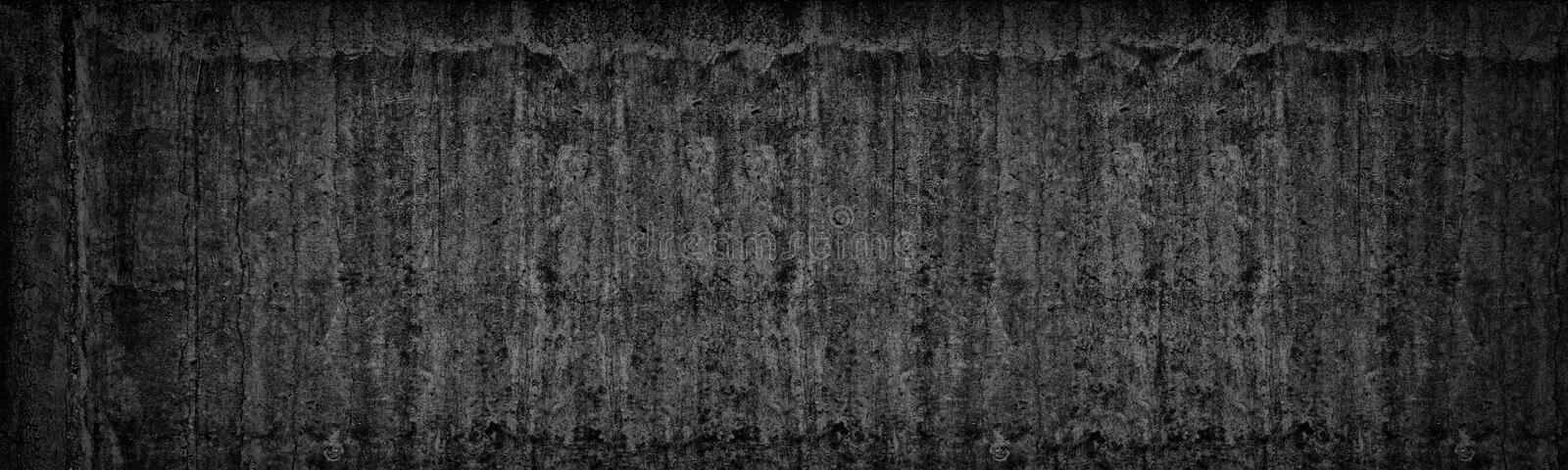 Old black concrete wall wide texture. Dark gray cement background stock photo