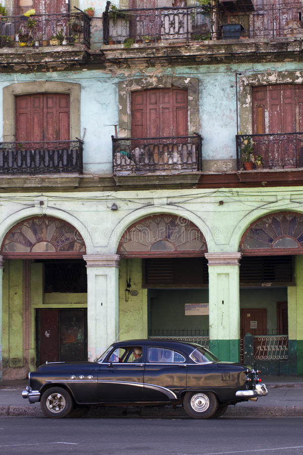 Old black Cuban car and dilapidated building royalty free stock photos