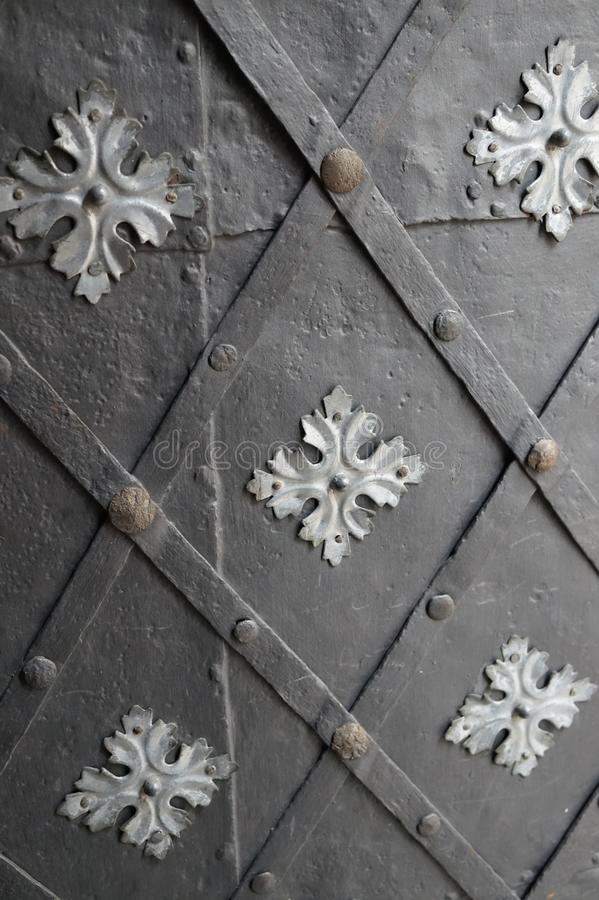 Old black iron door background, texture, wallpaper, pattern royalty free stock photos