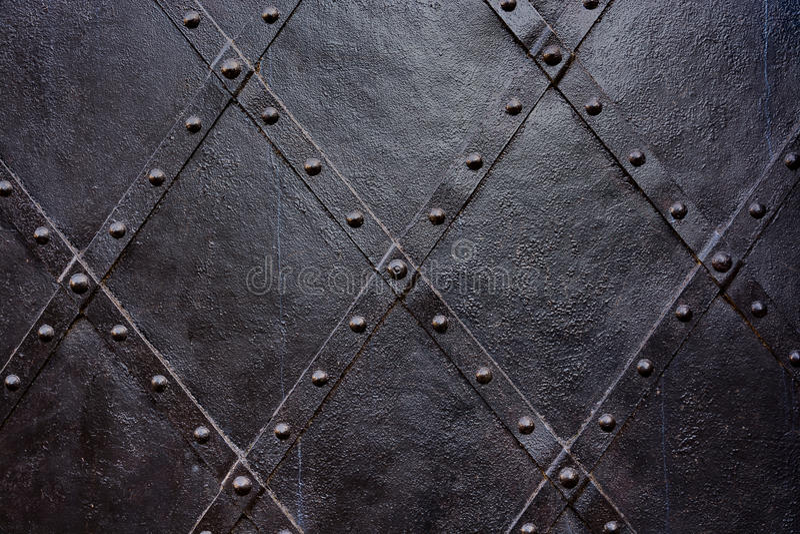 Old black iron door background, texture, wallpaper, pattern stock photo