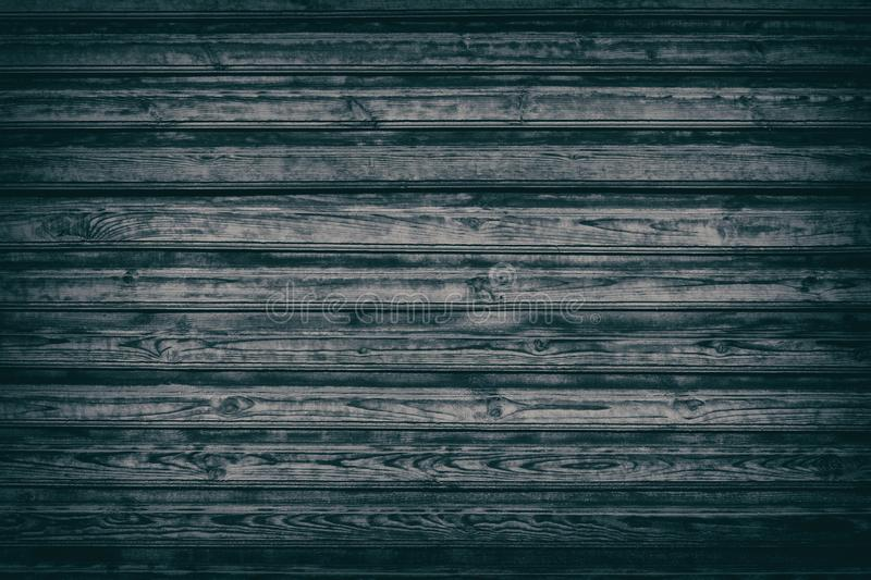 Old black knotty wood background of rough wooden boards stock photo