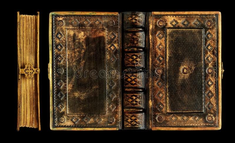Old black leather book with the brass frame, clasp and gold finish over the leather. Captured over the black background royalty free stock photography