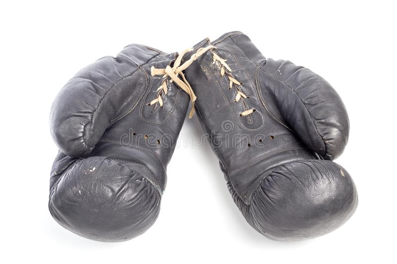 Old black leather boxing gloves isolated on white background with shadows lying on flat surface royalty free stock images