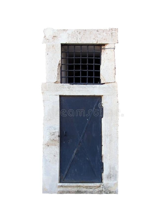 Old black metal iron door with white stone marble frame portal isolated on white background closeup royalty free stock images