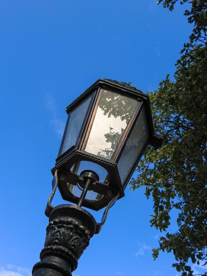 Old metal street lamp. Old black metal street lamp stock image