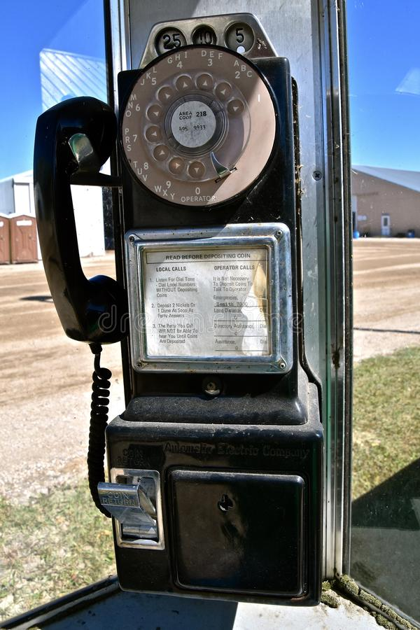 Old phone ion a telephone booth stock images
