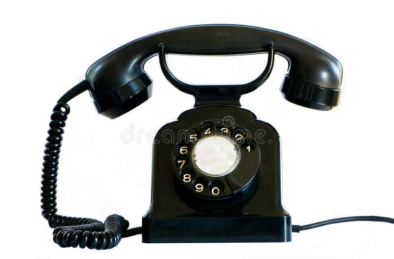 Old black phone on white. stock images