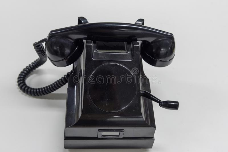 Old black phone on a white background stock images