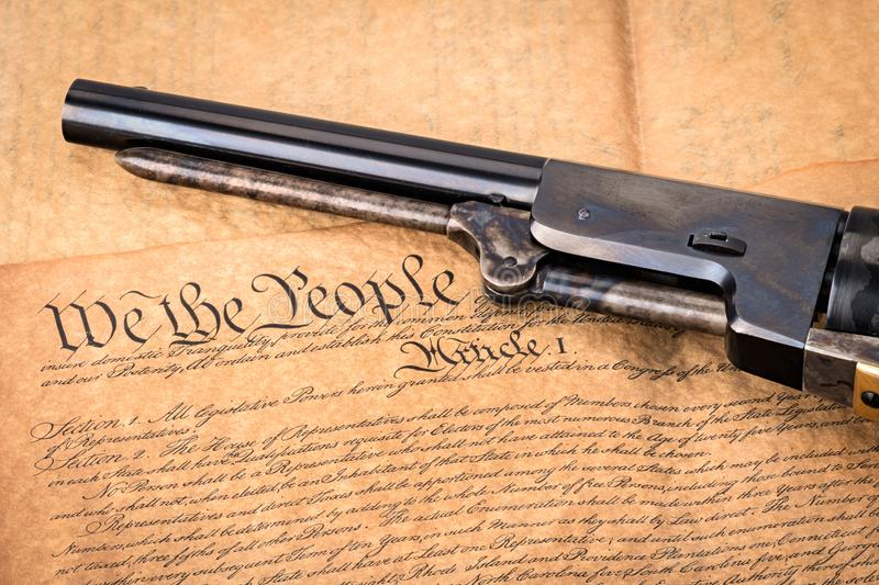 Old black powder pistol on a copy of the constitution and title royalty free stock photo