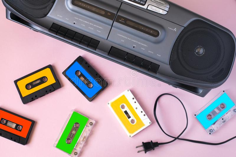 Old black retro cassette music audio tape recorder and retro cassette tape collection stock photos