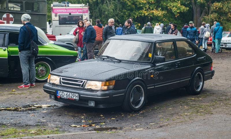 Old black Saab 900 driving stock photos