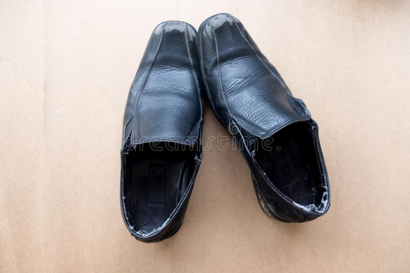 Old black shoe on brown background royalty free stock images