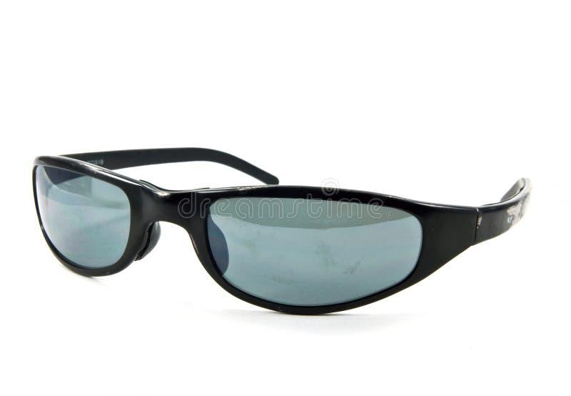 Old black sunglasses. Shot on white background stock photos