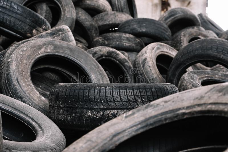 Old black tires in a landfill for recycling stock photos