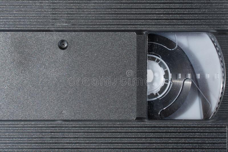 Old black VHS video tape cassette close-up as background or pattern stock photography