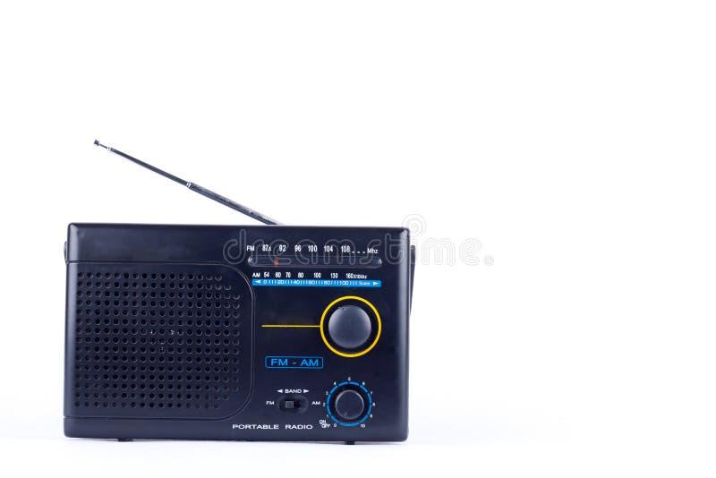 Old black vintage retro style AM, FM portable radio transistor receiver on white background isolated stock image