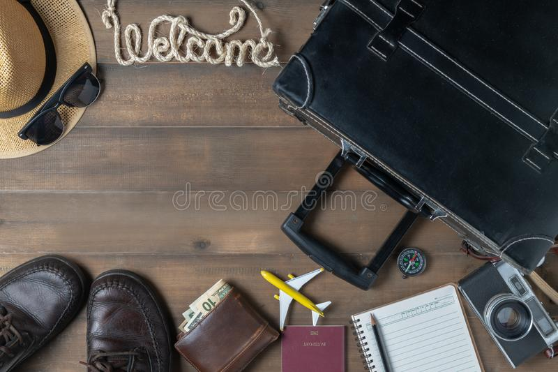 Old black vintage suitcase with welcome text royalty free stock image