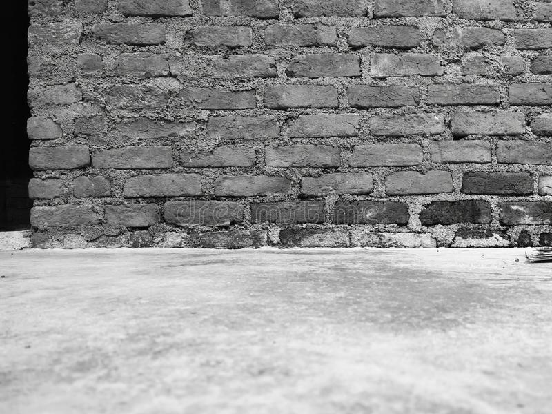 Old black and white brick wall. stock photos