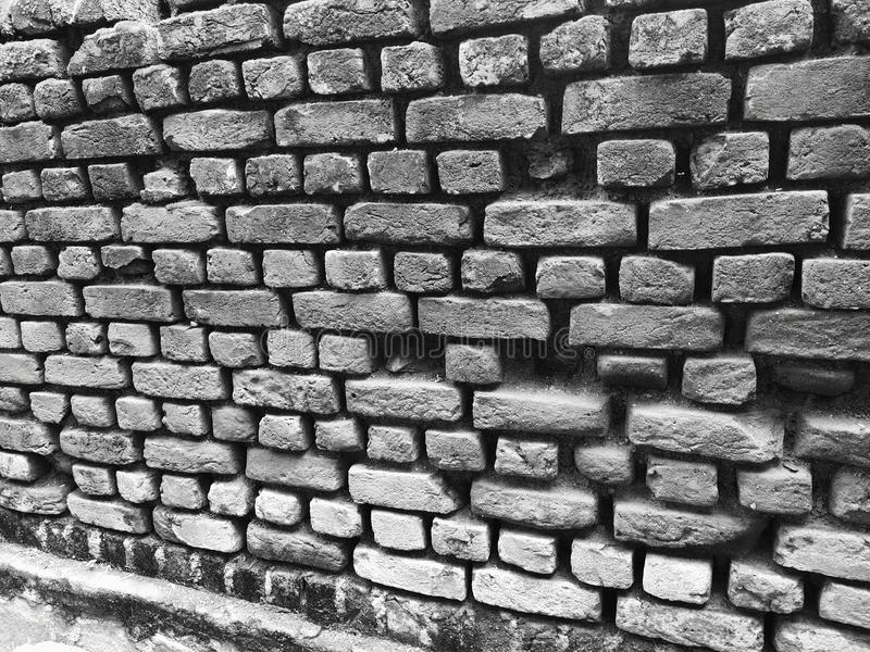 Old black and white brick wall. stock images