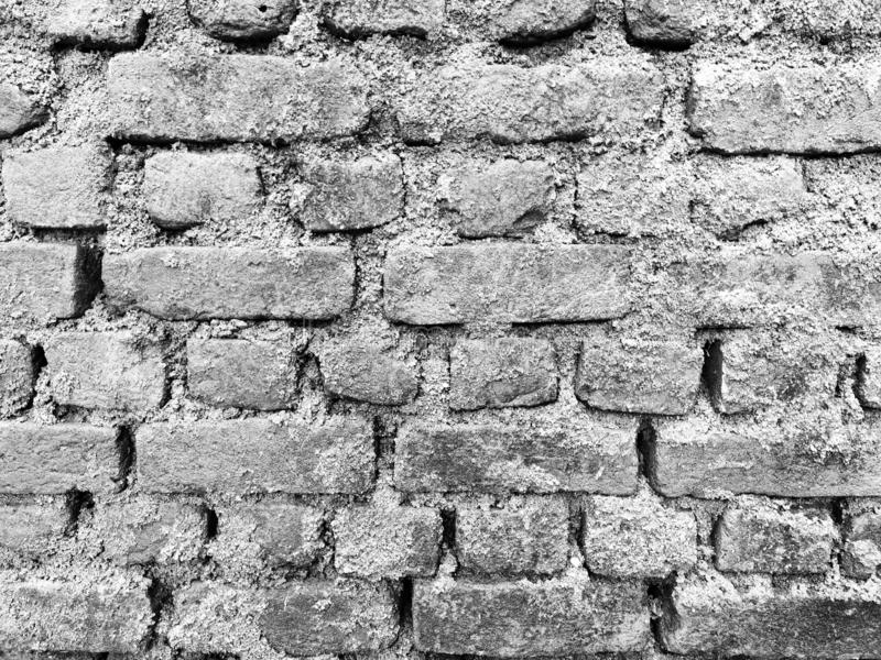 Old black and white brick wall. royalty free stock images
