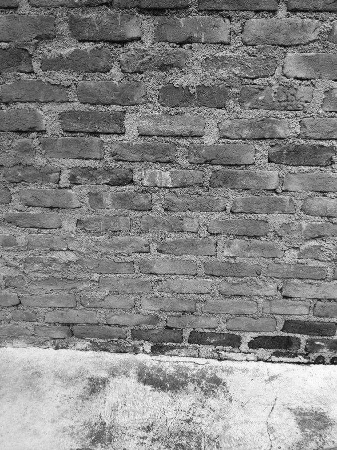 Old black and white brick wall. royalty free stock photos