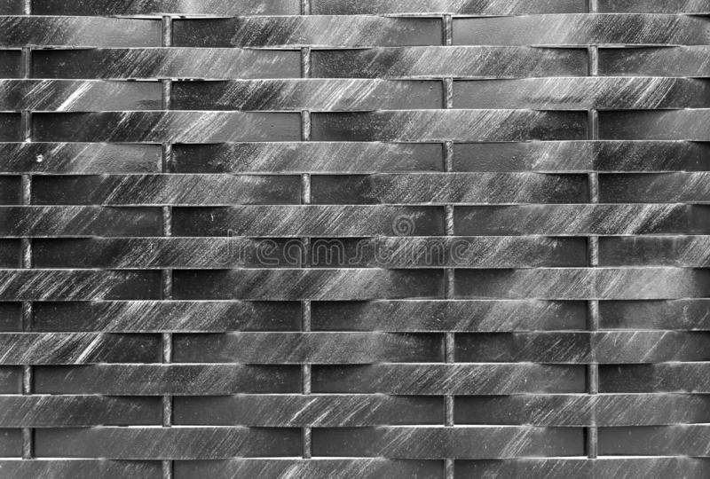 Old black and white metal wall background. Horisontal and vertical lines gate. City or rural rtexture. Dark geometric wallpaper royalty free stock photos