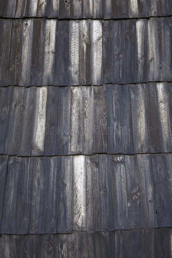 Dark Wood Pattern Background Texture. Roof scale wooden tiles royalty free stock photo