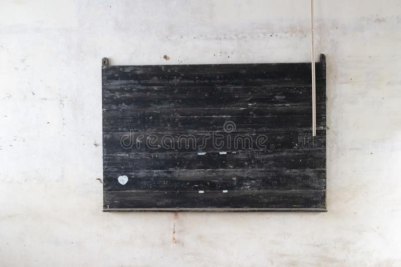 Old blackboard in an abandoned Chinese School royalty free stock photo