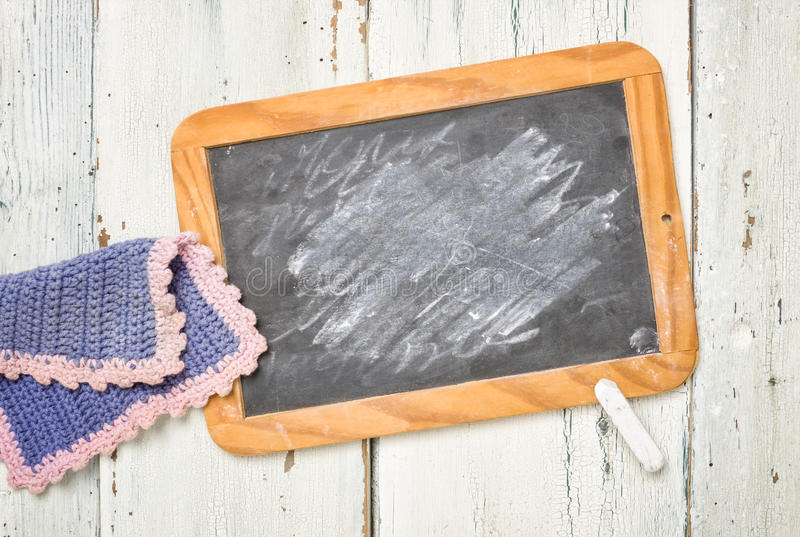 Old blackboard with chalk and a cleaning cloth stock photo