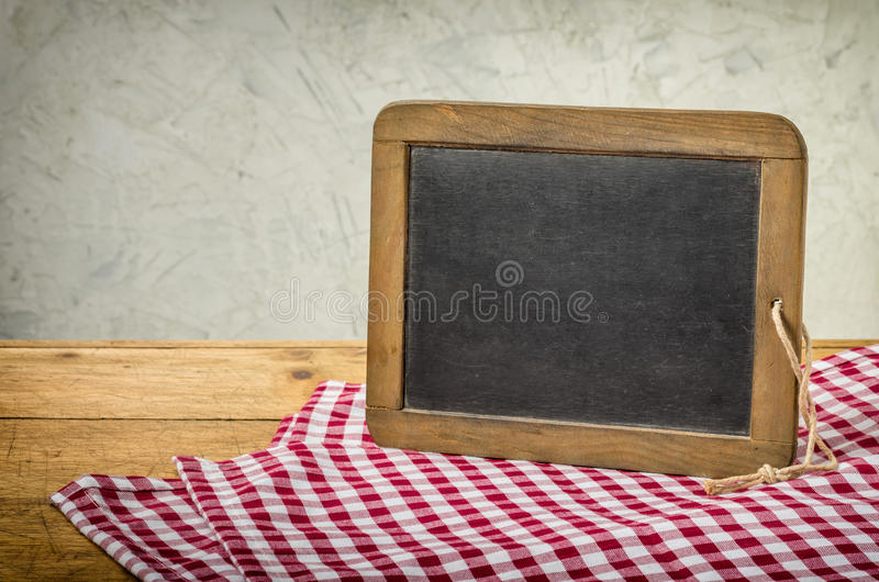 Old blackboard in a rustic setting royalty free stock image
