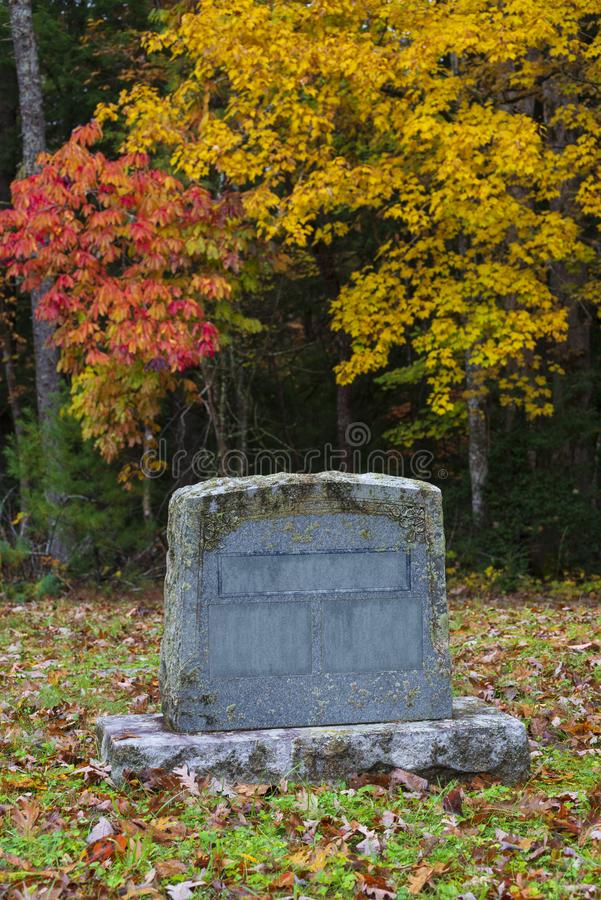 Old Blank Gravestone With Copy Space in Autumn stock images
