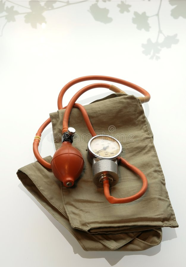Old blood pressure cuff isolat. Ed on white background royalty free stock images
