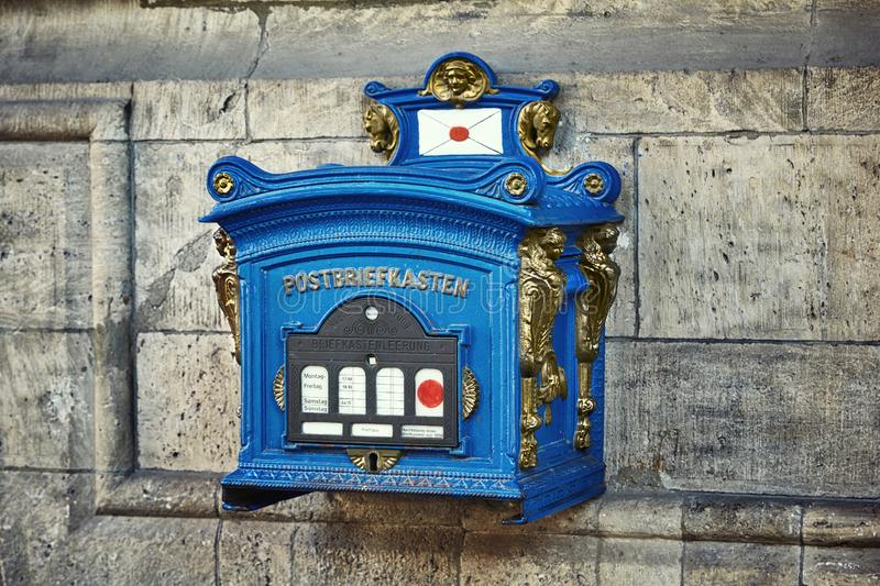 Old blue and bronze vintage post box in Erfurt, Thuringia, Germany royalty free stock images
