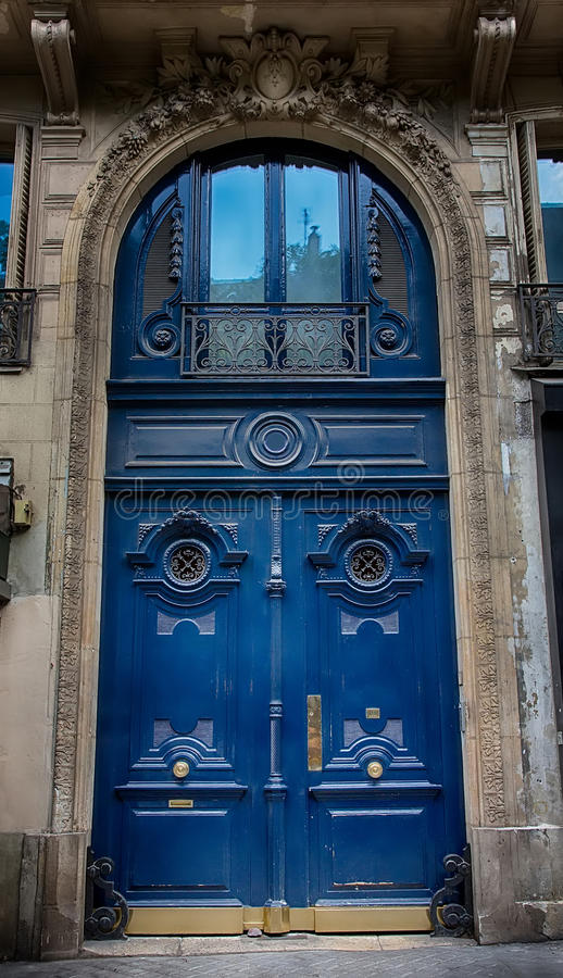 Old Blue carved ornate door in Paris, France. royalty free stock image