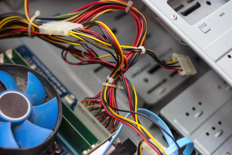 Old blue cooler fan with motherboard and colorful cables inside a computer. Old blue cooler fan with motherboard and colorful cables inside a computer stock photos