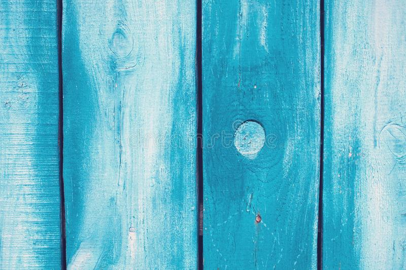 Old blue cracked wooden boards. Cracks in the tree. Fence. Texture royalty free stock photography