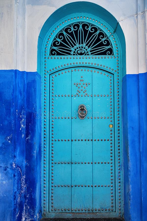 Old blue door with knocker. royalty free stock image