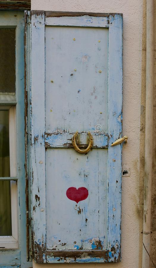 An old blue door with painted heart royalty free stock images