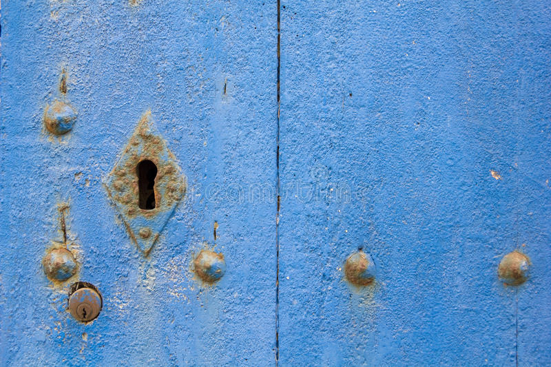 Old blue door with rusty latch. stock photos