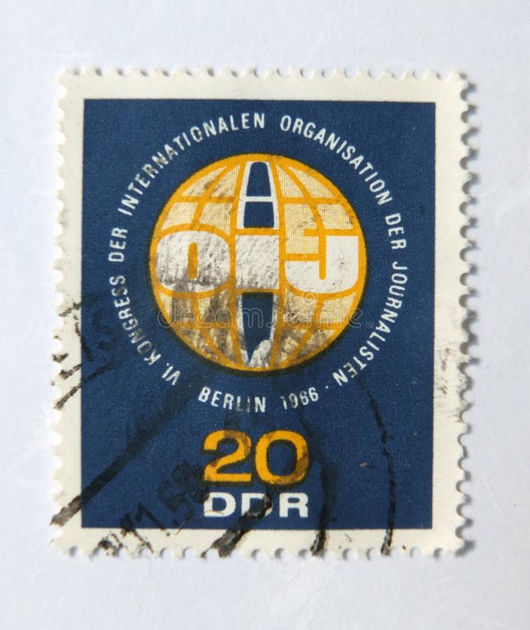 An old blue east german postage stamp celebrating in international journalists conference in 1966 stock image