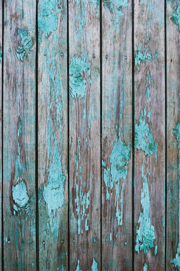 Old blue fence. Texture of old wooden fence painted in green royalty free stock photography
