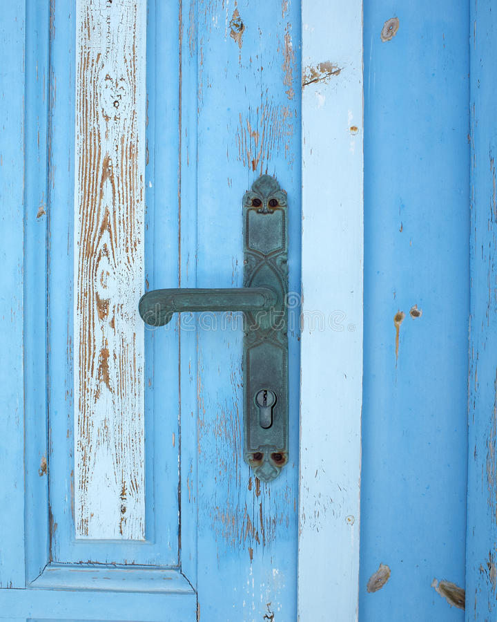 Old blue grunge door detail, handle stock image